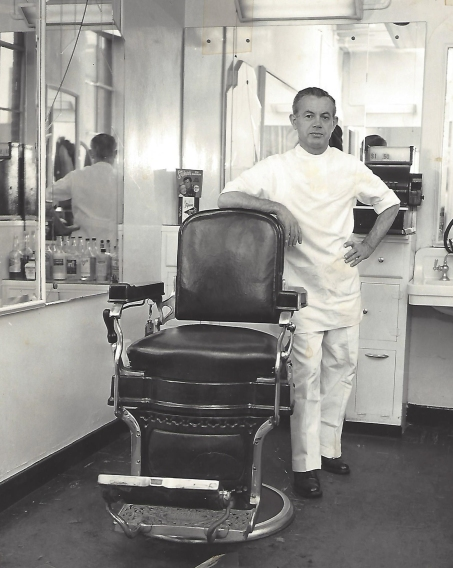 Vince's father in his barber shop